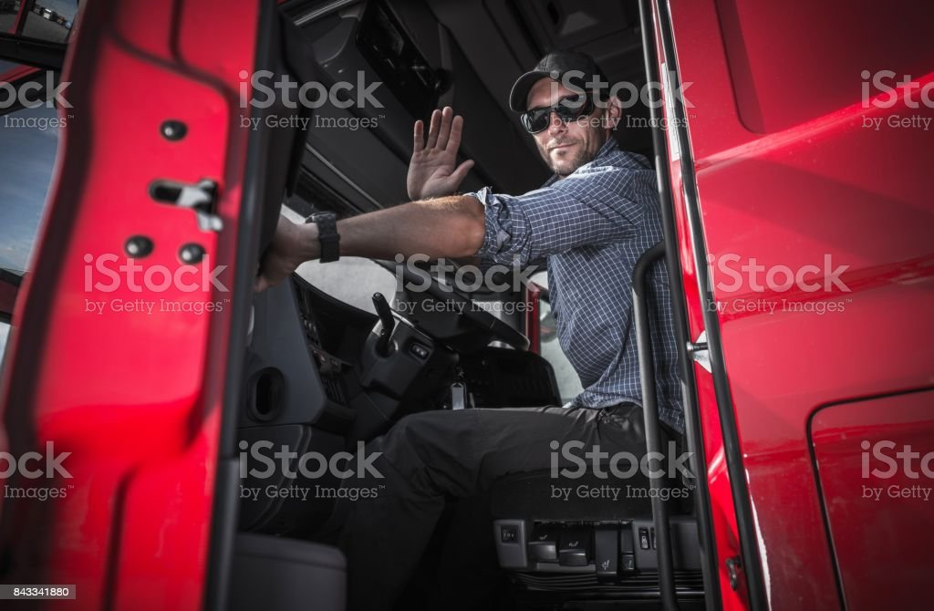 Truck Driver Leaving Warehouse stock photo
