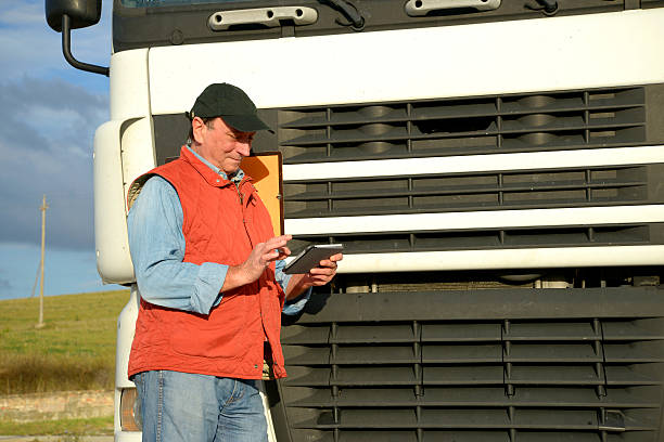 Truck driver messaging stock photo