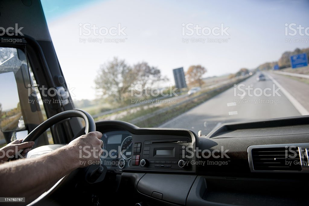 Truck driver on german autobahn stock photo