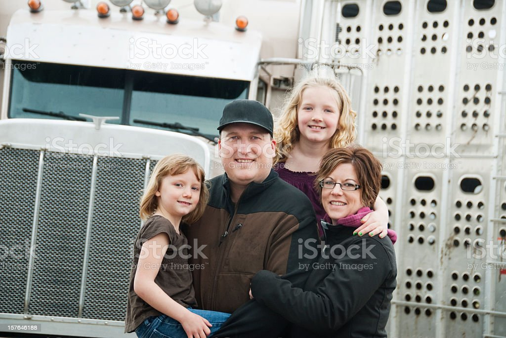 Truck driver posing with two daughters and wife  royalty-free stock photo