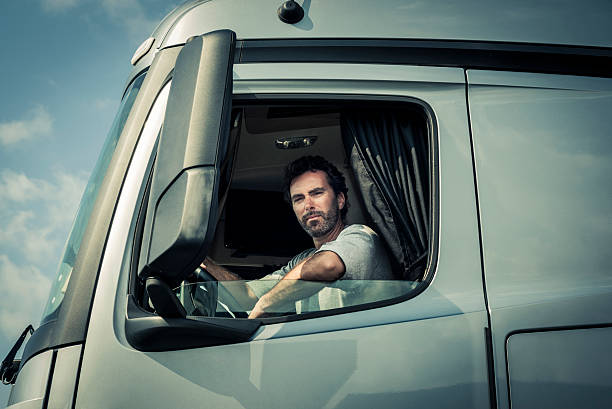 Truck Driver Sitting In Cab stock photo