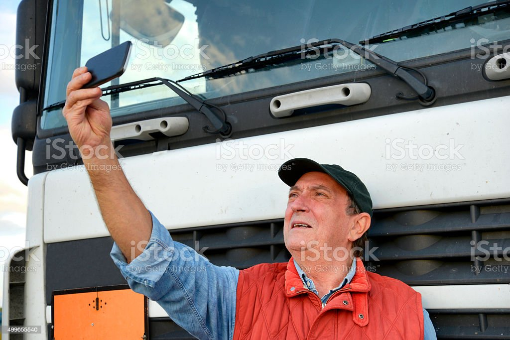 Truck driver taking a selfie stock photo