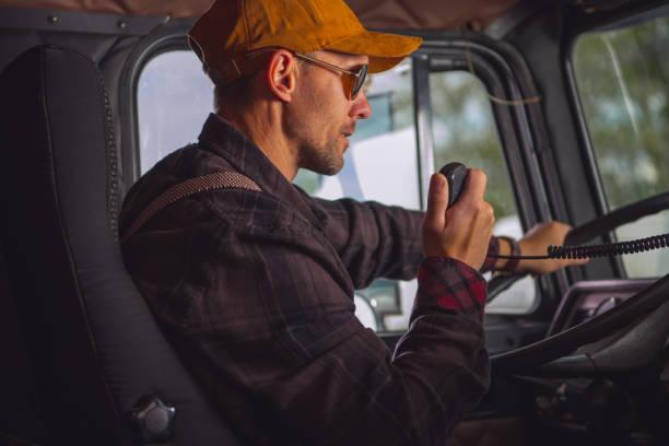Truck Driver Talking On Radio. stock photo