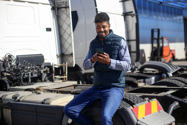 Truck driver texting stock photo