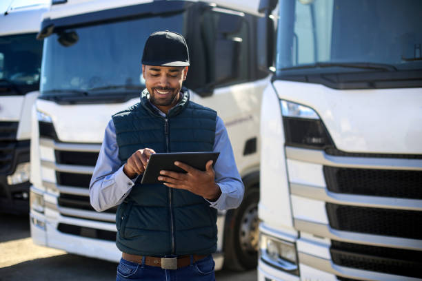 Truck driver using a tablet stock photo