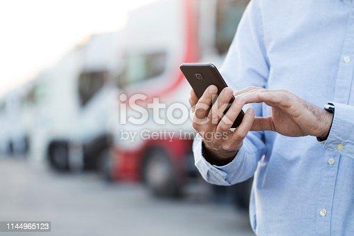 Unrecognizable Caucasian male using his phone.