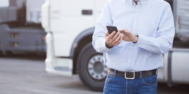 Truck driver using an app stock photo