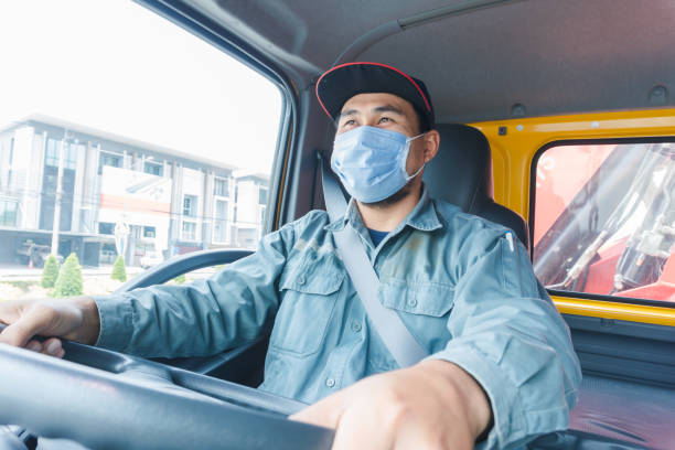 truck driver wearing a mask - essential workers stock pictures, royalty-free photos & images