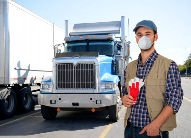 Truck driver with mask during covid-19 pandemic stock photo