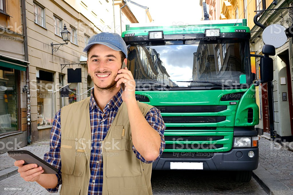 Truck driver with smartphone and tablet foto stock royalty-free