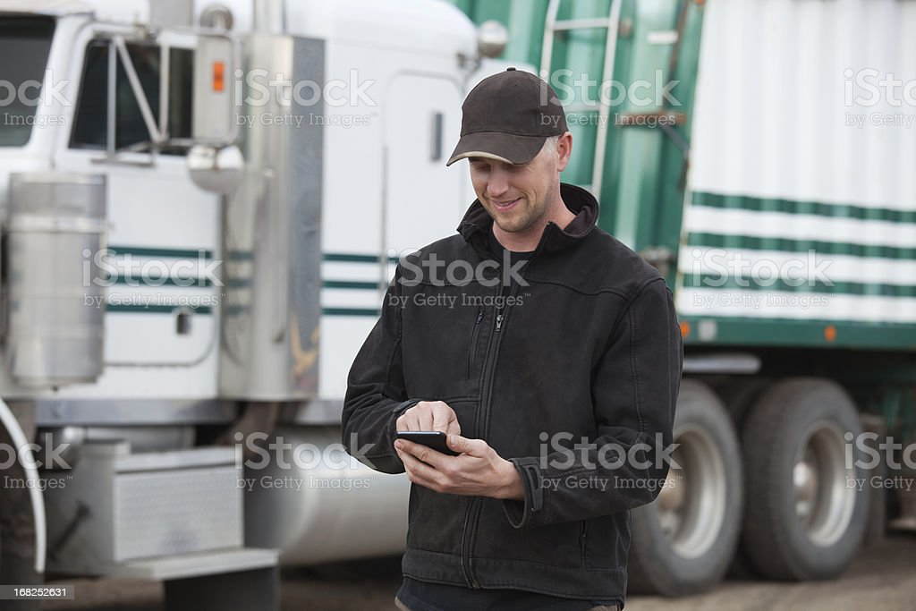 Truck Driver with Smartphone royalty-free stock photo