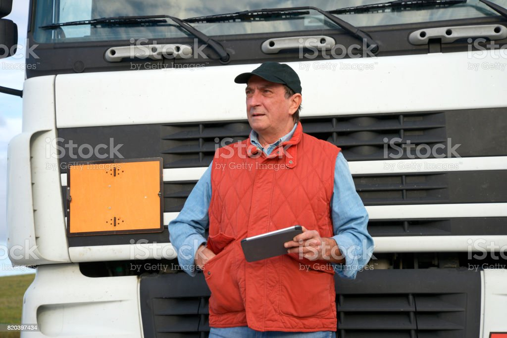 Truck driver with tablet stock photo
