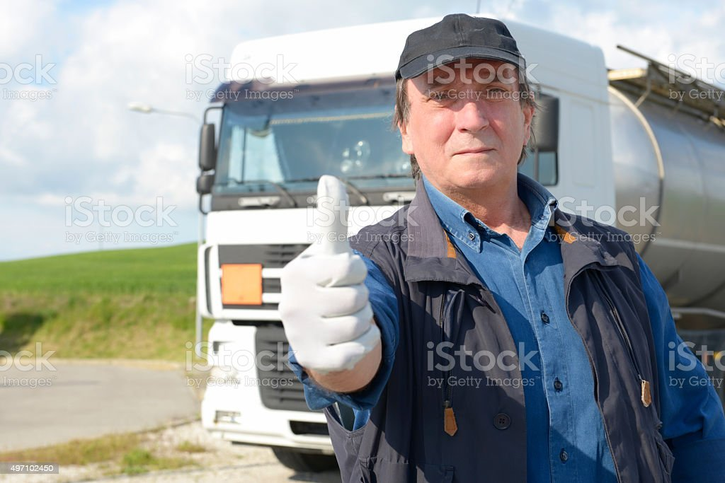 Truck driver with thumbs up stock photo