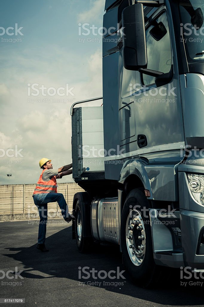 Truck Driver Working On Truck stock photo
