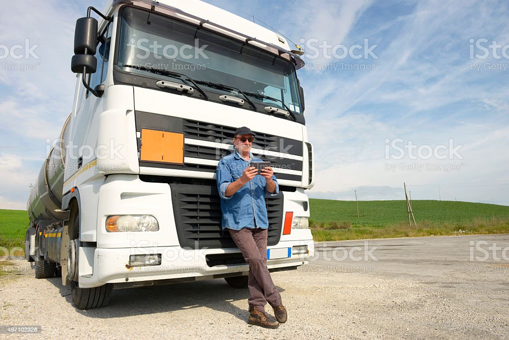 Truck driver working with smartphone stock photo