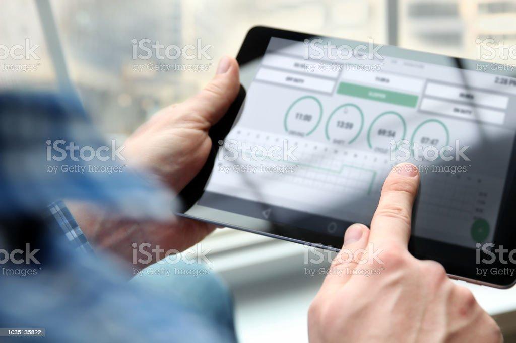 Truck driver writing electronic log books stock photo