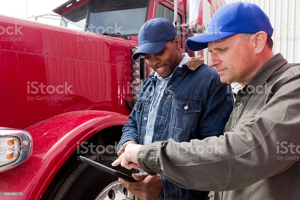 Truck Drivers and Tablet Computer stock photo