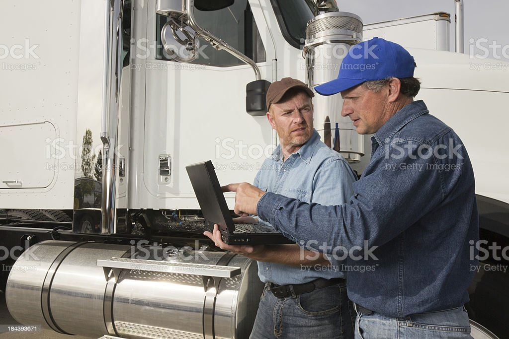 Truck Drivers on a Laptop royalty-free stock photo