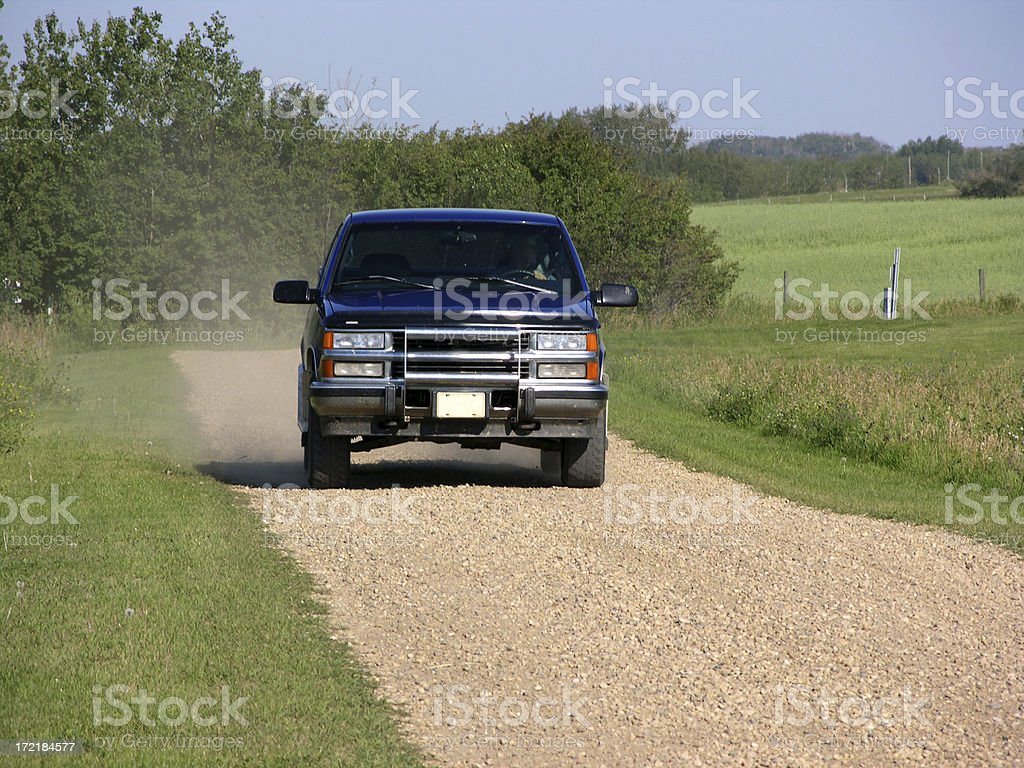 Truck driving down country road stock photo