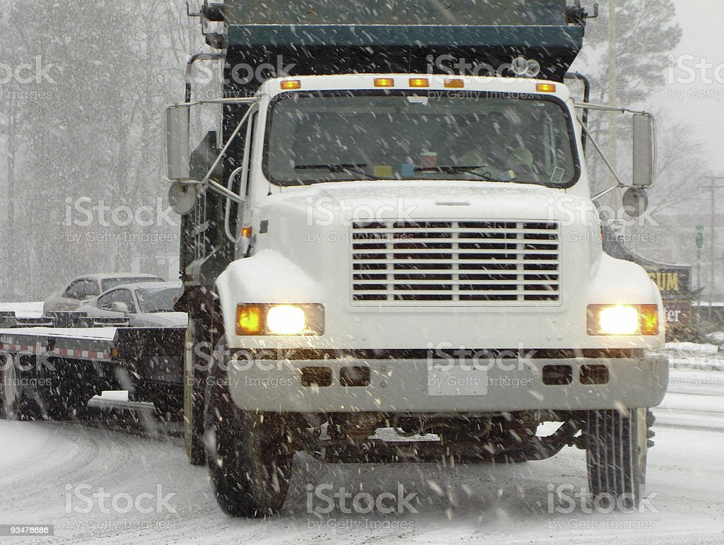 Truck driving in snow royalty-free stock photo