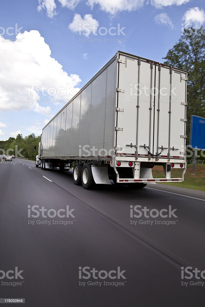 Truck driving on a highway royalty-free stock photo
