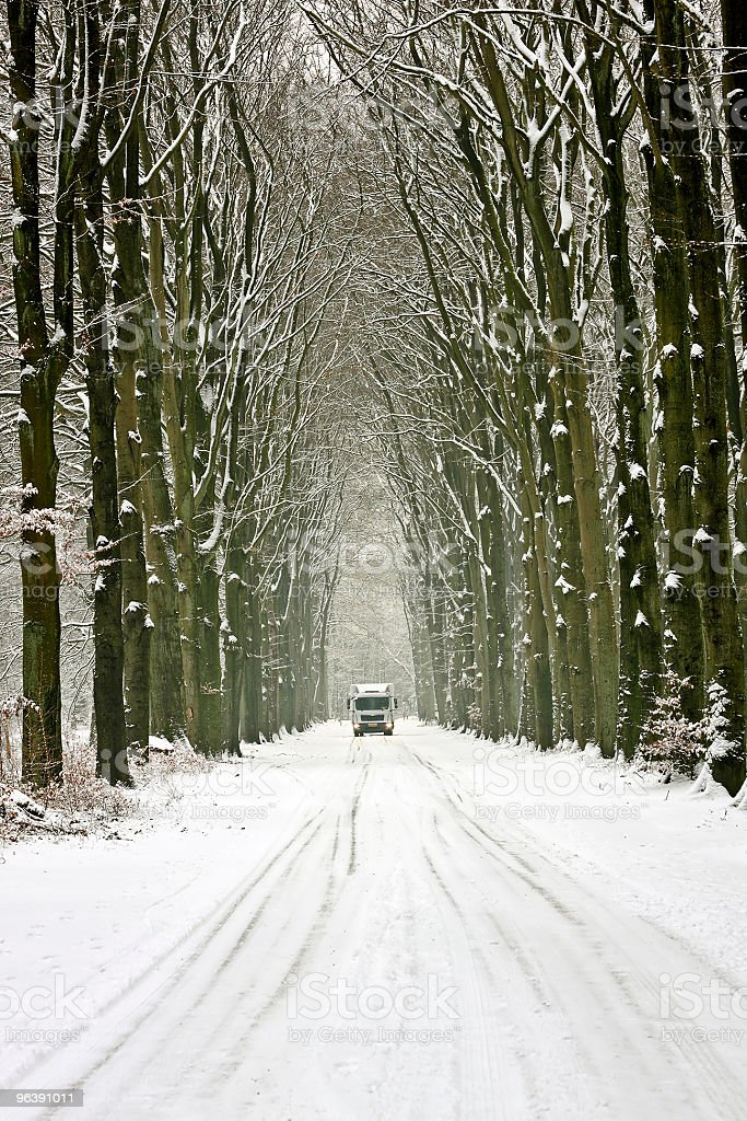 Truck driving on a snowy countryroad in the Netherlands - Royalty-free Color Image Stock Photo