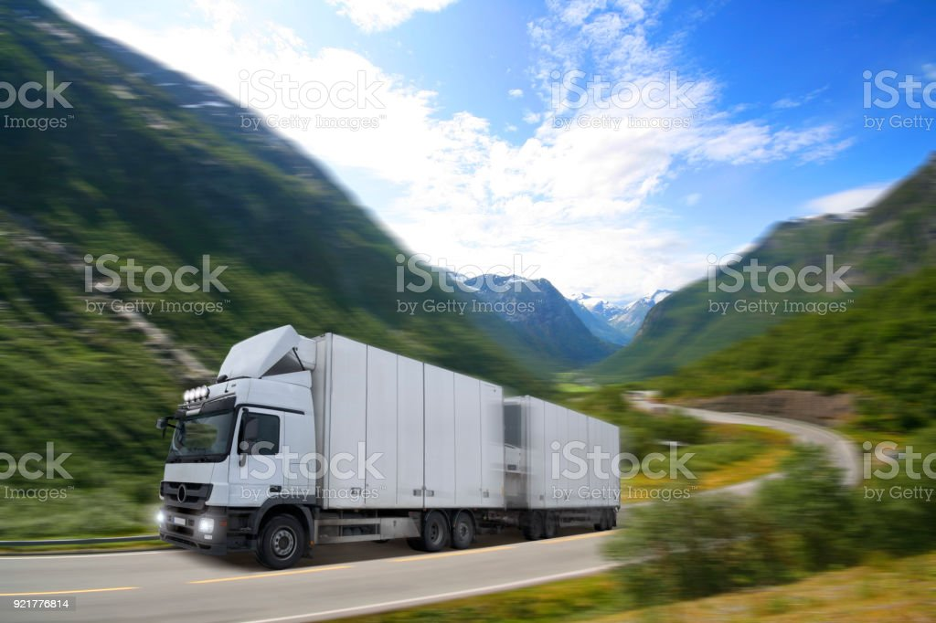 Truck driving on road in Norway. stock photo