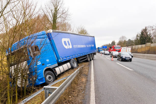 truck driving on the highway into the embankment - impaired driving stock photos and pictures