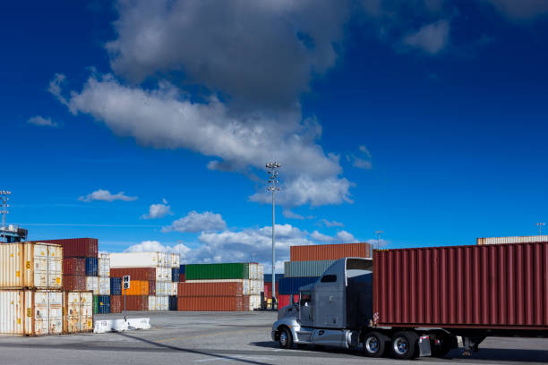 truck driving through shipping terminal - halbergman stock pictures, royalty-free photos & images