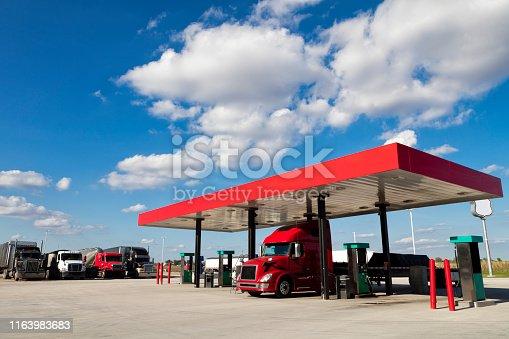 Semi truck at truck stop gas pump, American transport concept, Missouri, United States.