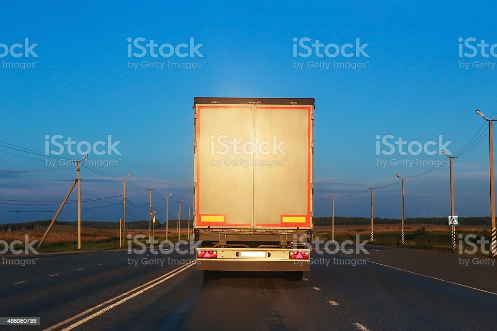 truck goes on highway stock photo