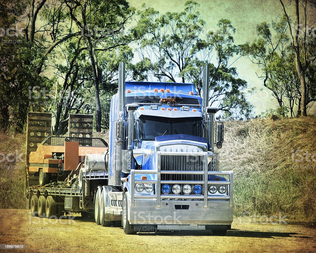 Truck hauling heavy machinery in Queensland royalty-free stock photo