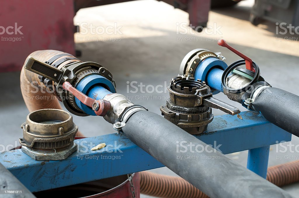 Truck Hoses for fuel station, pumps and oil barrels stock photo