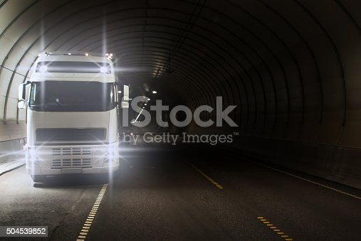 1023119734 istock photo Truck in a long road tunnel 504539852