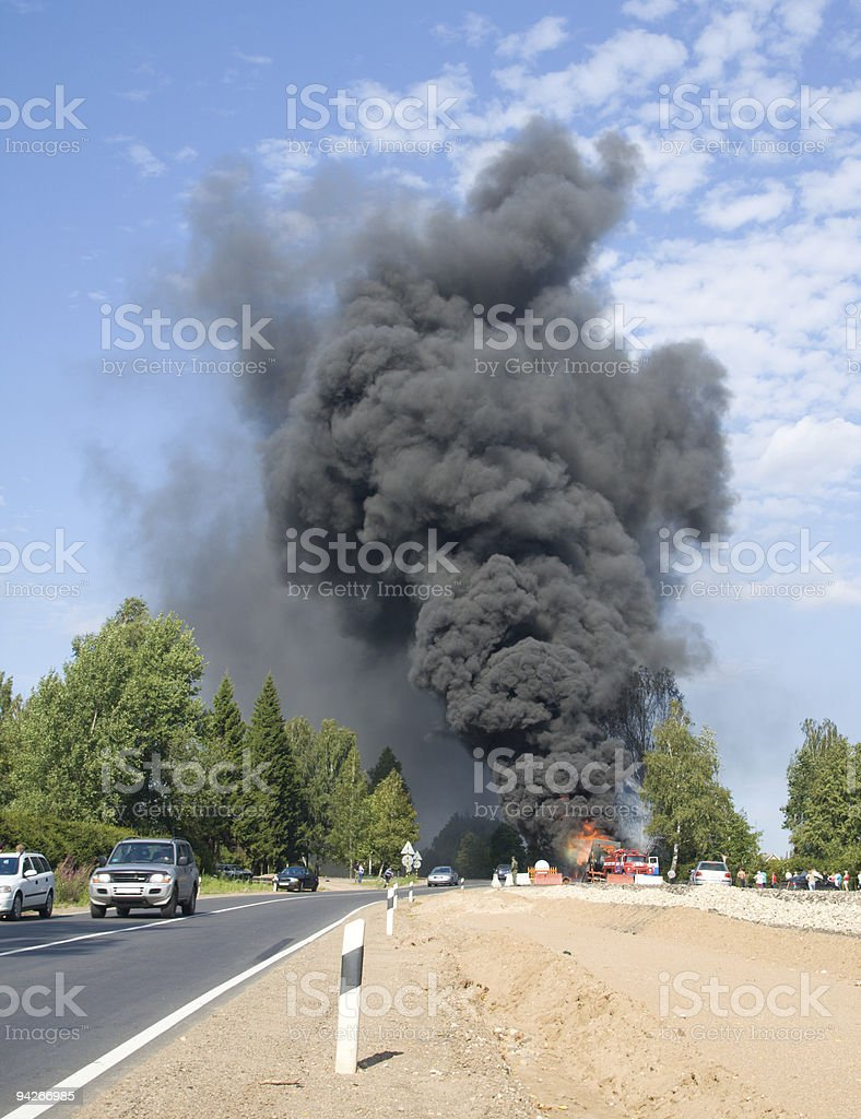 truck in fire with black smoke on the road stock photo