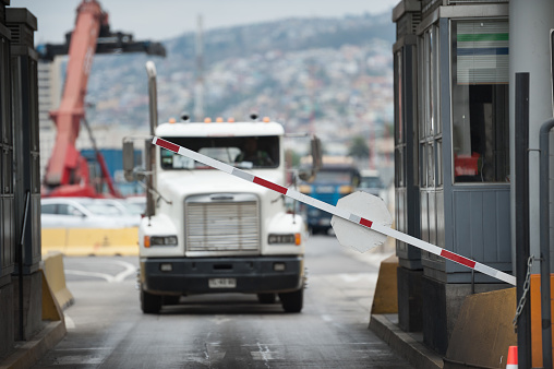 Truck in industrial port area being let through customs