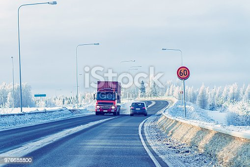 1127834626 istock photo Truck in Snow Road in winter Lapland at Finland 976688800
