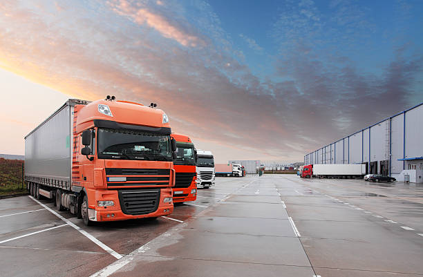 truck in warehouse - cargo transport - lorries unloading stock photos and pictures