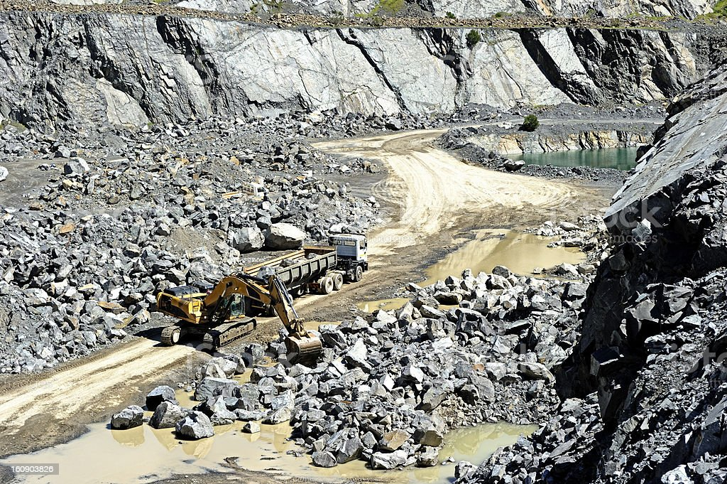 Truck loaded in open pit gravel mine royalty-free stock photo