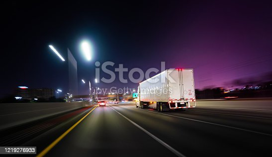 istock Truck Miami Florida highway at night with deliveries 1219276933