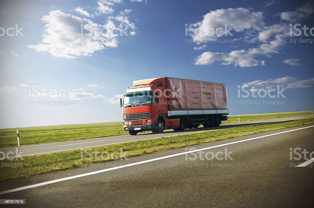 truck moving on a road royalty-free stock photo