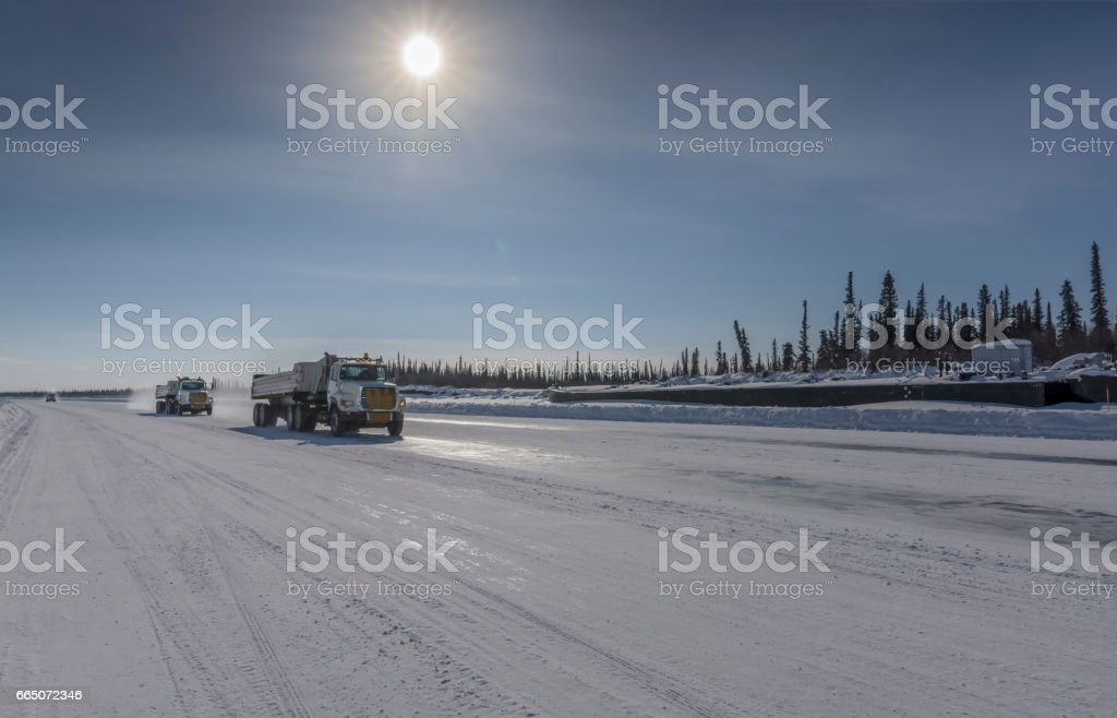 Truck Moving on the Mackenzie River Ice Road stock photo