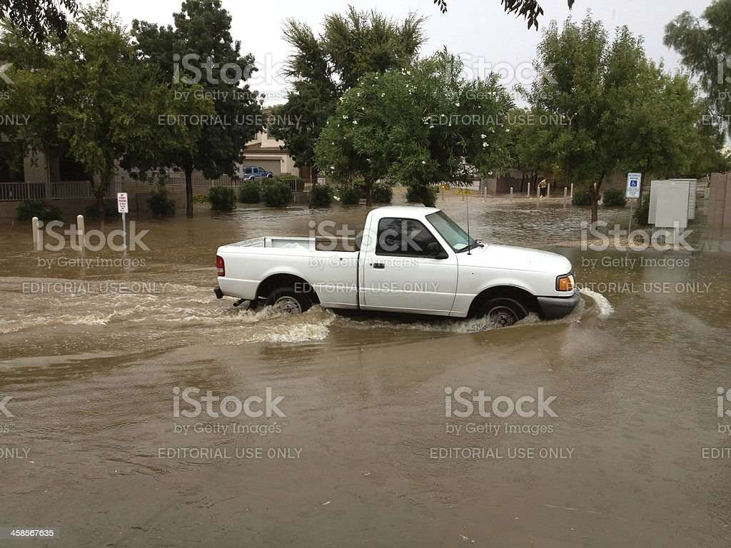 Truck moving thru flooded area stock photo