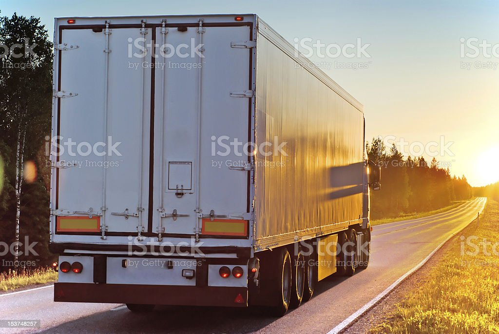 Truck on a road in the evening royalty-free stock photo