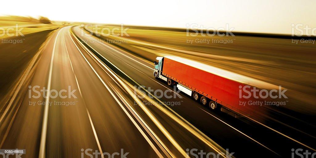 Truck on asphalt road motion blur stock photo