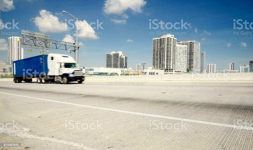 Truck on Causeway, Miami. stock photo