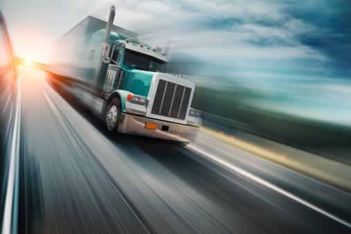 American truck speeding on freeway, blurred motion.