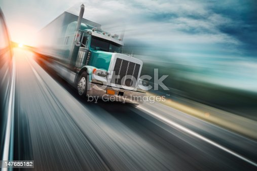 American truck speeding on freeway, blurred motion.