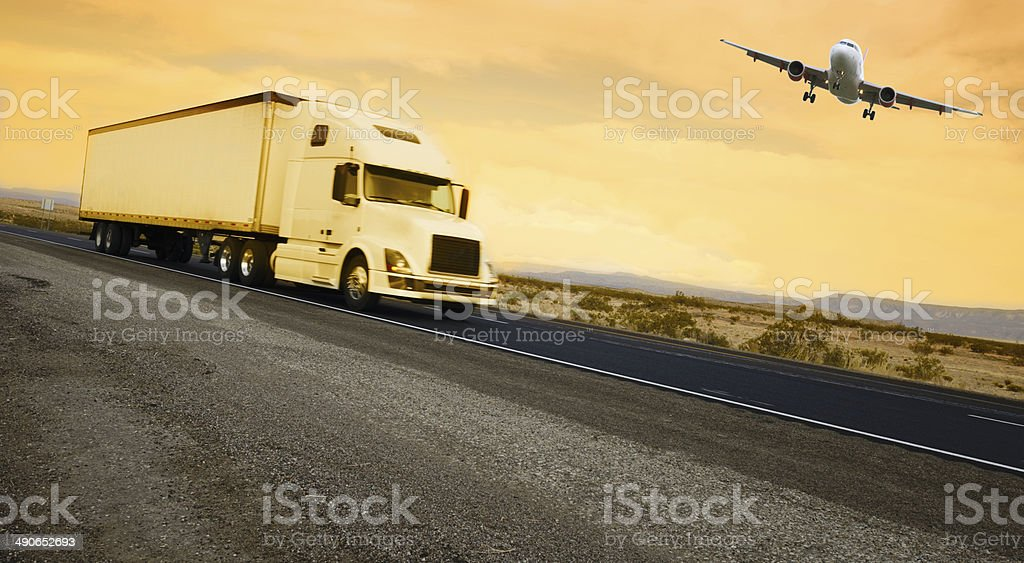 Truck on highway and airplane, California stock photo