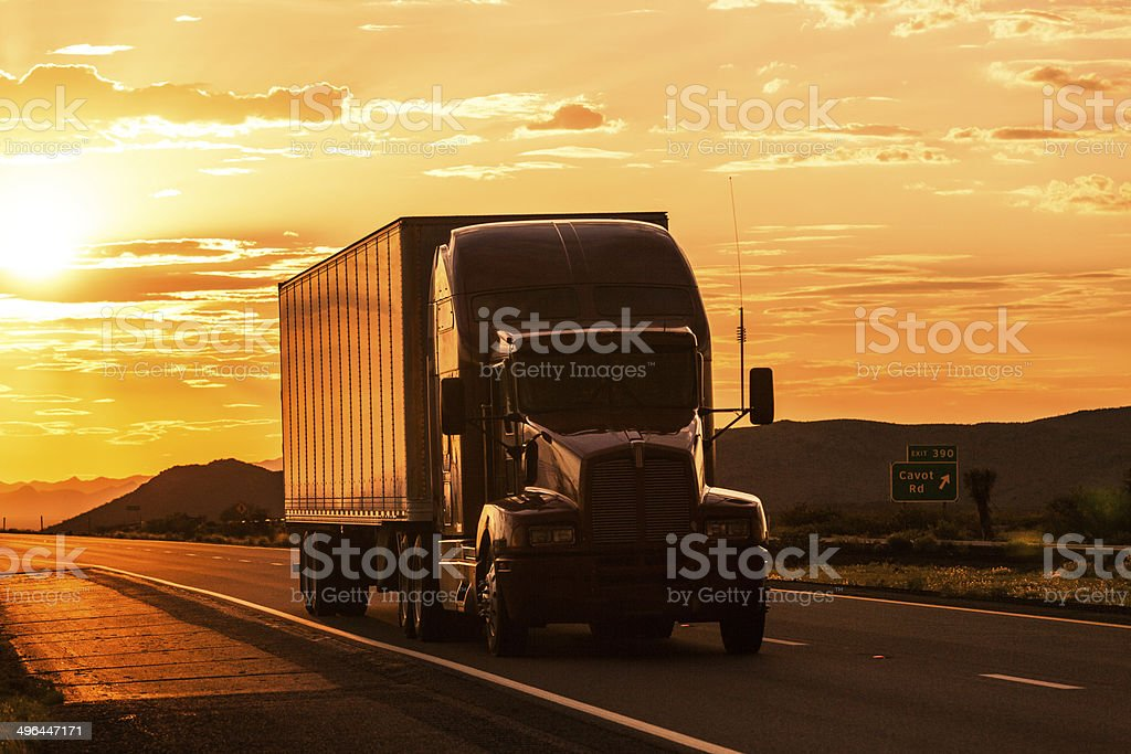 Truck on Highway at Sunset royalty-free stock photo